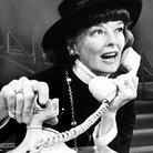Katharine Hepburn using a retro telephone