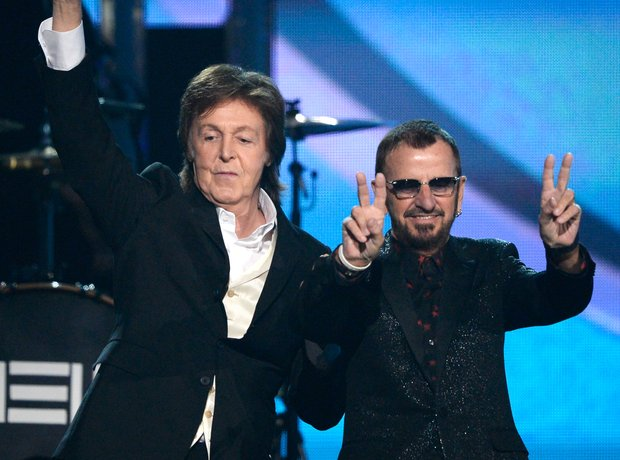 Sir Paul McCartney and Ringo Starr in black suits