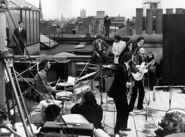 The Beatles perform on the rooftop at Apple
