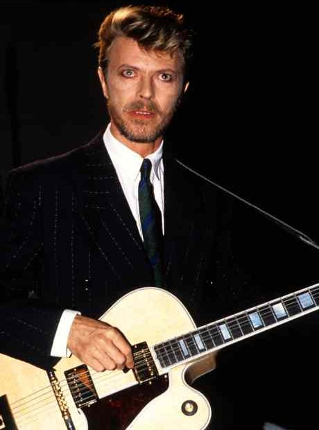 David Bowie of Tin Machine performing on stage