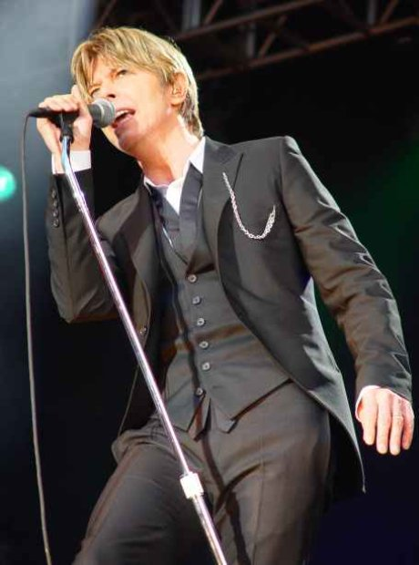David Bowie photographed performing live in Manche